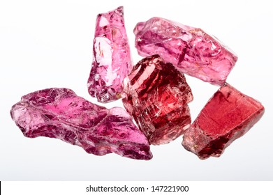 Rhodolite garnet. A pile of uncut, raw and rough Crystals in Bright Purple red.