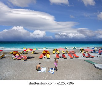 RHODOS BEACHES - JUNE 25, 2015: Aegean Sea, washed beautiful beaches of Greece Islands is popular recreational destination for tourists from around the world.