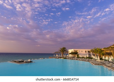 Rhodos, Greece - August 2016: Beautiful sunset over a beach resort with infinit pool in the Ixia gulf, on the western coast of the Rhodos island, near the Rhodos city