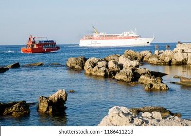 RHODOS, GREECE - SEPTEMBER 2015: Large and small ferry nearby Rhodos harbour