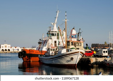 RHODOS, GREECE - SEPTEMBER 2015: Various ships and boats docked in Rhodos harbour.