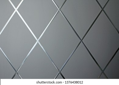 Rhombus background. Gray geometric background of rhombuses and glass. Glass gray background. Copy space for your text.