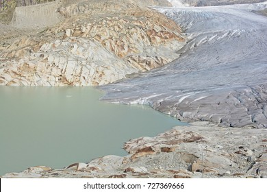 The Rhone Glacier and the glacial lake which marks the birth of the River Rhone in the Swiss Alps. With the sheet protection over the ice to reduce melting