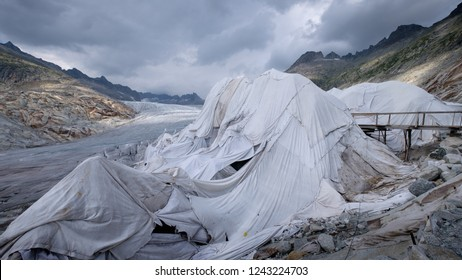 Rhone glacier, source of Rhone river, melting and retreating due to global warming. Rhone glacier is loosing up to 2 meters in length every year. Therefore the glacier gets covered in clothes.