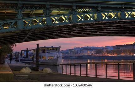 RHONE RIVER, LYON, FRANCE - November 15, 2017: colorful dusk at the Rhone river in Lyon, France.