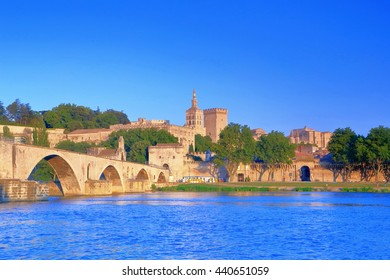 Rhone river near the bridge and distant Cathedral and Papal Palace (Palais des Papes), Avignon, Provence, France