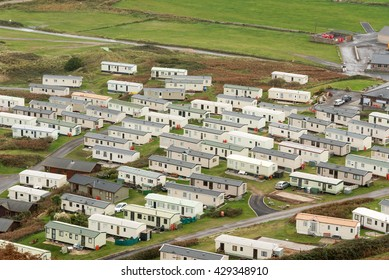 Rhossili, Wales, , UK - October 22 2015 :High view from a hillside looking down onto a mobile home site near the sea.