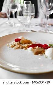 Rhubarb crumble on white plate