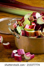 Rhubarb in a pan on a wooden table