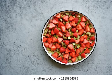 Rhubarb strawberry crumble with chia seeds cooking. Summer Food Background