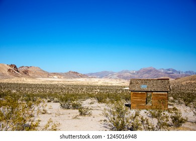 Rhyolite is a ghost town in Nye County, Nevada. It is in the Bullfrog Hills, about 120 miles northwest of Las Vegas, near the eastern edge of Death Valley. The town began in early 1905