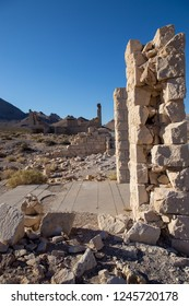 Rhyolite is a ghost town in Nye County,  state of Nevada. It is in the Bullfrog Hills, about 120 miles northwest of Las Vegas, near the eastern edge of Death Valley. The town began in early 1905