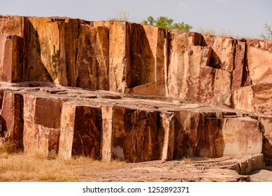 Rhyolite is an igneous volcanic rock of felsic (silica-rich) composition.  Due to  high silica content rhyolite lava is very viscous & flows slowly and tends to pile up and form lava domes.