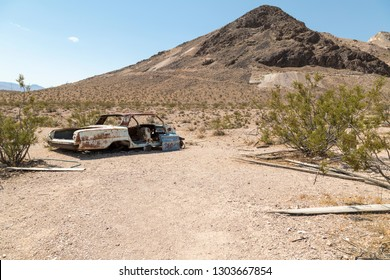 Rhyolite, Nevada, USA: September 1st 2017 - Abandoned car at the ghost town of Rhyolite in Nevada