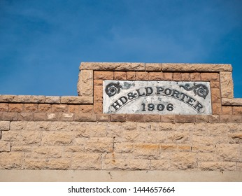 Rhyolite, Nevada/USA - June 2, 2019:   Store front sign on the ruined wall of the Porter Store in the desert ghost town of Rhyolite, Nevada, USA