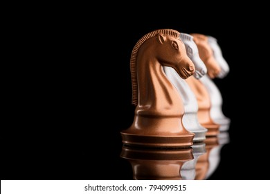 rhythm created from chess pieces horses knight on a black background