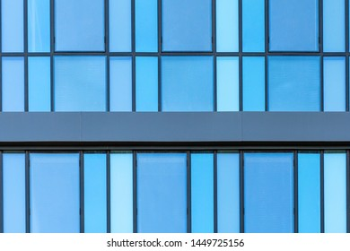 Rhythm glazing facade of the building. Modern architecture - glass facade of an office building - aluminum profiles and blue-tinted glass with a mirror effect