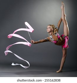 Rhythmic gymnast doing vertical split with ribbon