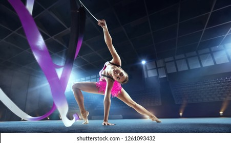 Rhythmic gymnast in professional arena.