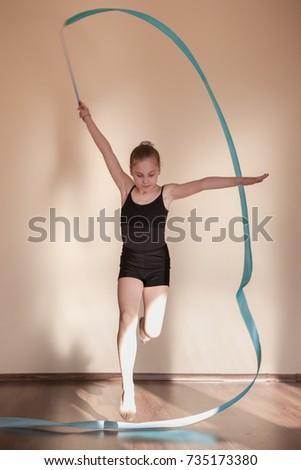 Girls gymnasts warm up. stock photo. Image of leisure