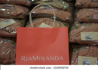 Ria Miranda's clothes packages are ready to be sent by reseller to customer. Ria Miranda is Indonesian fashion designer that produces women's Muslim clothing. Padang, Indonesia - October 28, 2019.