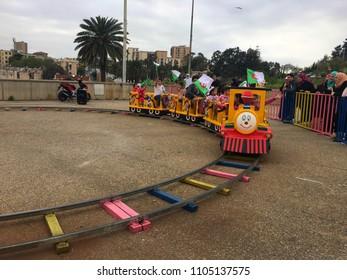 Riad Al Fath, Algiers, Algeria - April 7, 2018: A small train which is full of happy Algerian children.