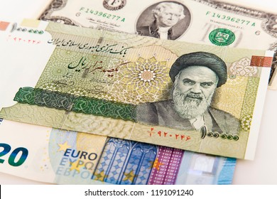 Rial of the Islamic Republic of Iran with the background of the dollar and the euro