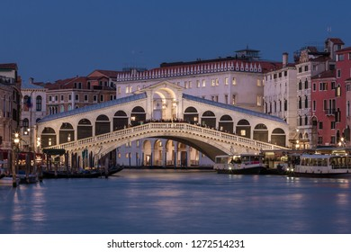 Rialto bridge and Grand Canal at night in Venice, Italy.
