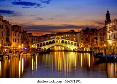 Rialto Bridge and Grand Canal at sunrise in Venice, Italy