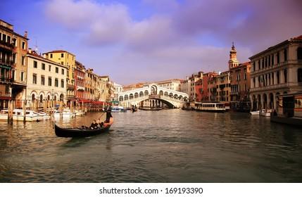 Rialto bridge in the Grand Canal of Venice