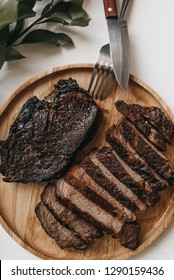 Rib eye steak on a wooden plate - Carnivore Diet