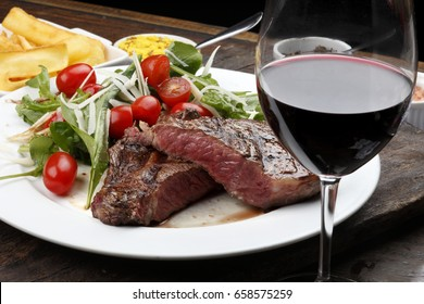Rib fillet with salad red wine
