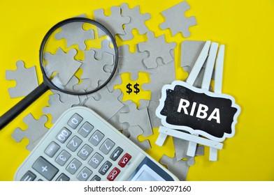 Riba (Interest or Usury) word text on black board - Islamic Finance concept