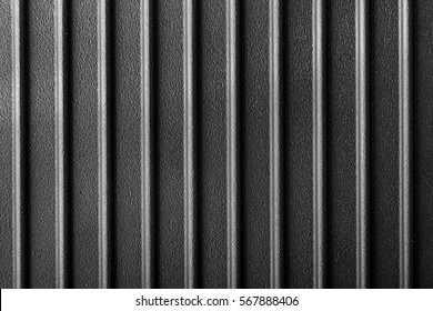 ribbed cast iron surface, metal texture, textured black background