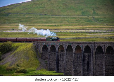 Ribblehead, Yorkshire / England - July 2018 : The Flying Scotsman runs across the Ribble Head viaduct in the Yorkshire Dales