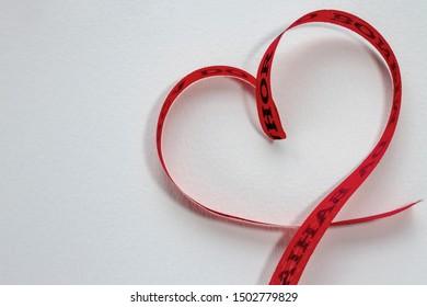 Ribbon from Bahia (Lembrança do Senhor do Bonfim), heart shape. Concept of wishing love.