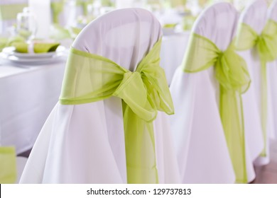 ribbon decoration on wedding chairs cover