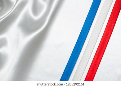ribbon with france flag color on white silk background