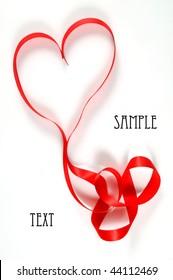 Ribbon in heart shape on white background