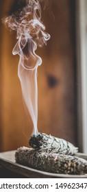 ribbon of smoke from burning sage bundle