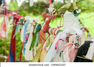 Ribbons, cloth and gifts hanging from the branches of a tree at the Holy Well shrine for Saint Brigid of Kildare.