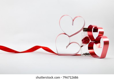 Ribbons shaped as hearts on white background, valentine day concept, happy valentine.