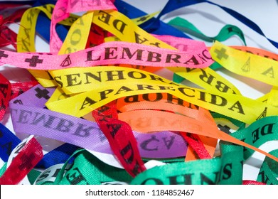 "ribbons for tying on wrist, bracelets, with the sayings ""remembrance of our Lady appeared"", or ""lembranca de nossa senhora aparecida"" in portuguese, from Brazil - Aparecida - SP"