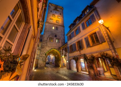 RIBEAUVILLE, FRANCE - DECEMBER 12, 2014: The clock tower as part of the city gates in Ribeauville, Alsace, France in the evening.