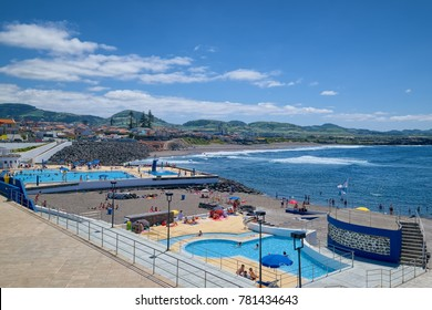 RIBEIRA GRANDE, AZORES, PORTUGAL - JUNE 29, 2017: Municipal outdoor swimming pool of Ribeira Grande town at coast of Atlantic Ocean, located on Sao Miguel island of Azores, Portugal.