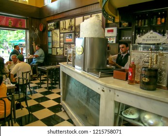 Ribeirao Preto, SP, Brazil, February 14, 2004. Bartender pouring from tap fresh beer into the glass in Pinguin pub and restaurant in Ribeirao Preto city