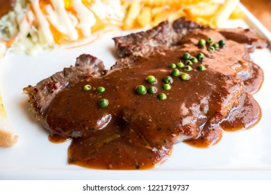 Ribeye Steak with Gravy on plate