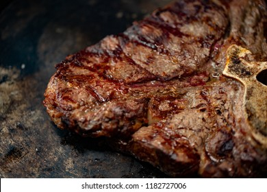 Ribeye steak on grill in meat restaurant