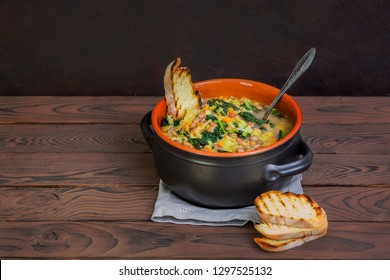 Ribollita - a famous Tuscan bread soup,  the main ingredients are:  leftover bread, beans, lacinato kale, cabbage,  carrot,  celery, potatoes and onion.