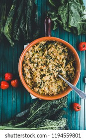 Ribollita, Tuscan soup classic, old-fashioned meal peasants, on a rustic ceramic bowl, over a green wooden background,top view